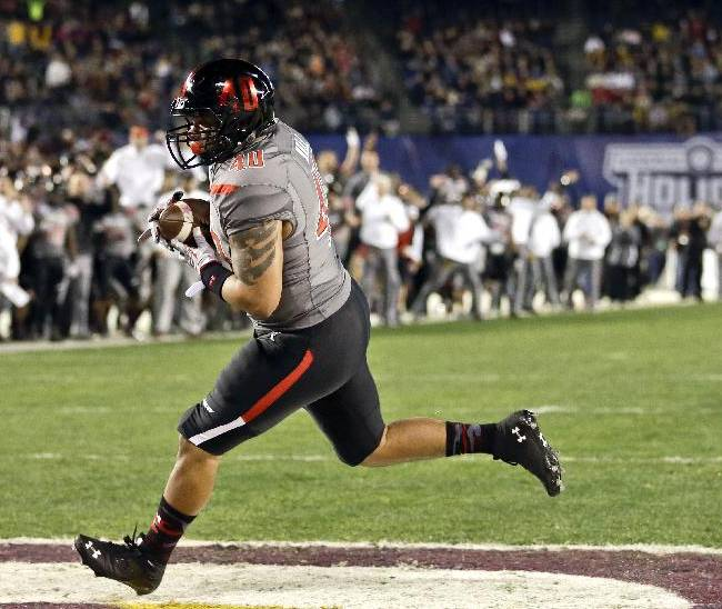 Texas Tech running back Rodney Hall cradles four-yard pass for a touchdown against Arizona State during the first half of the Holiday Bowl NCAA college football game, Monday, Dec. 30, 2013, in San Diego
