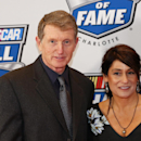 Bill Elliott, with wife Cindy, stops for photographers as he enters the Nascar Hall of Fame Friday, Jan. 30, 2015, in Charlotte, N.C. Elliott is a member of the 2015 Hall of Fame induction class.(AP Photo/Nell Redmond)