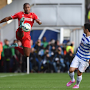 Liverpool's Glen Johnson, left, competes for the ball with Queens Park Rangers' Yun Suk-Young, during their English Premier League soccer match at Loftus Road, London, Sunday, Oct. 19, 2014