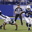Indianapolis Colts running back Ahmad Bradshaw (44) runs past Philadelphia Eagles inside linebacker Mychal Kendricks (95) during the first half of an NFL football game Monday, Sept. 15, 2014, in Indianapolis The Associated Press