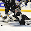 Los Angeles Kings goalie Jonathan Quick, right, stops a shot by St. Louis Blues right wing T.J. Oshie, left, during the third period of an NHL hockey game, Thursday, Oct. 16, 2014, in Los Angeles The Associated Press