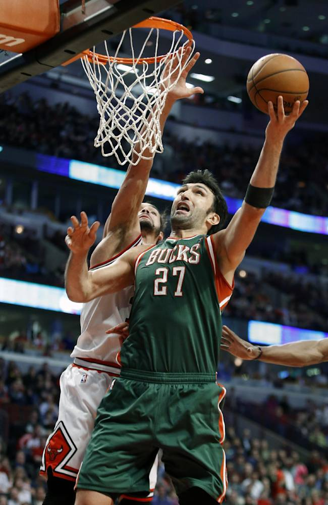 Milwaukee Bucks center Zaza Pachulia, right, goes to the basket as Chicago Bulls center Joakim Noah, left, defends during the second half of an NBA basketball game in Chicago, Friday, April 4, 2014. The Bulls won 102-90