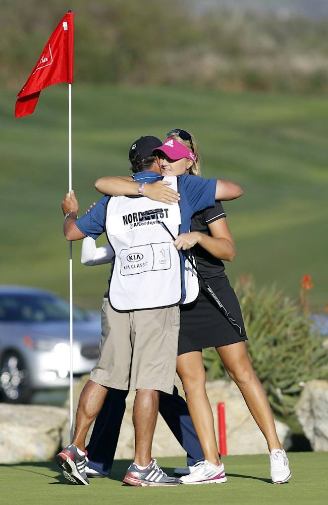 Anna Nordqvist, right, of Sweden, hugs her caddy Jason Gilroyed after winning the LPGA Kia Classic golf tournament in Carlsbad, Calif., Sunday, March 30, 2014