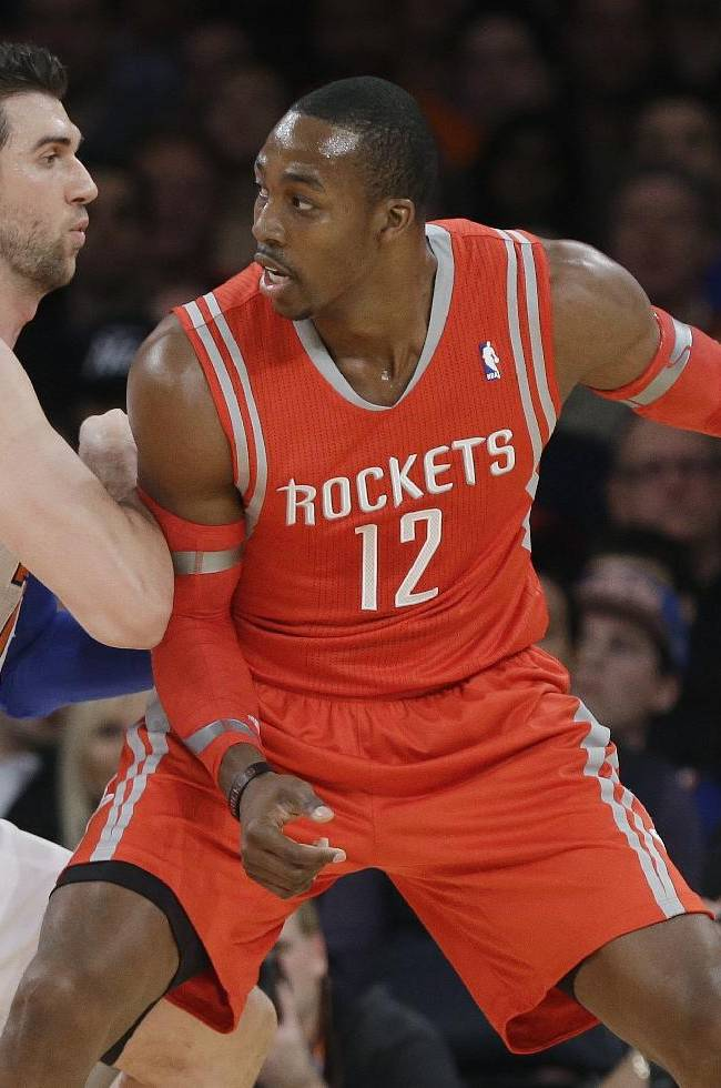New York Knicks' Andrea Bargnani, left, of Italy, defends Houston Rockets' Dwight Howard during the first half of an NBA basketball game Thursday, Nov. 14, 2013, in New York