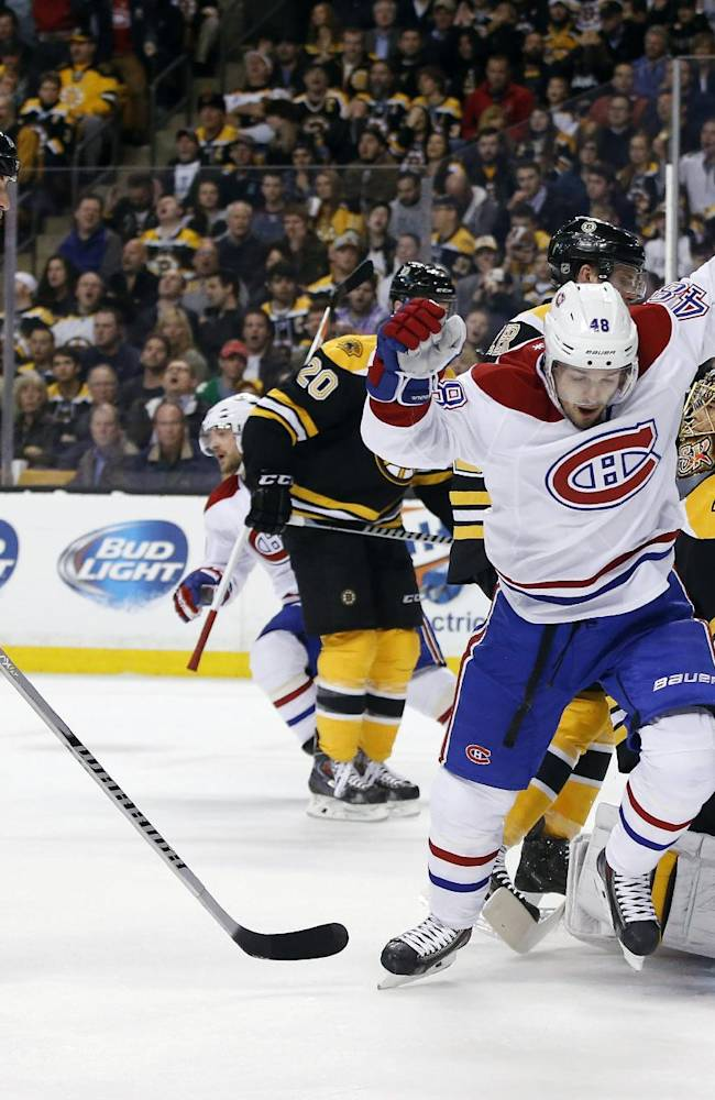 Montreal Canadiens center Daniel Briere (48) celebrates a goal by teammate P.K. Subban against Boston Bruins goalie Tuukka Rask (40) and defenseman Zdeno Chara (33) during the first period in Game 1 of an NHL hockey second-round playoff series in Boston, Thursday, May 1, 2014