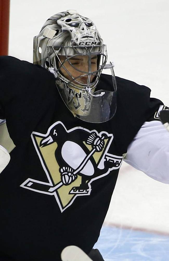 Pittsburgh Penguins goalie Marc-Andre Fleury (29) makes a save during the first period of an NHL hockey game against the Buffalo Sabres in Pittsburgh, Monday, Jan. 27, 2014
