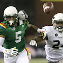 While being guarded by Nevada defensive back Charles Garrett (24), Hawaii wide receiver Quinton Pedroza (5) can't pull in a pass in the third quarter of the NCAA college football game, Saturday, Oct. 25, 2014, in Honolulu. Nevada defeated Hawaii 26-18 Th