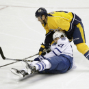 Nashville Predators defenseman Shea Weber (6) stops Toronto Maple Leafs left wing James van Riemsdyk (21) in the third period of an NHL hockey game Tuesday, Feb. 3, 2015, in Nashville, Tenn. The Predators won 4-3 The Associated Press