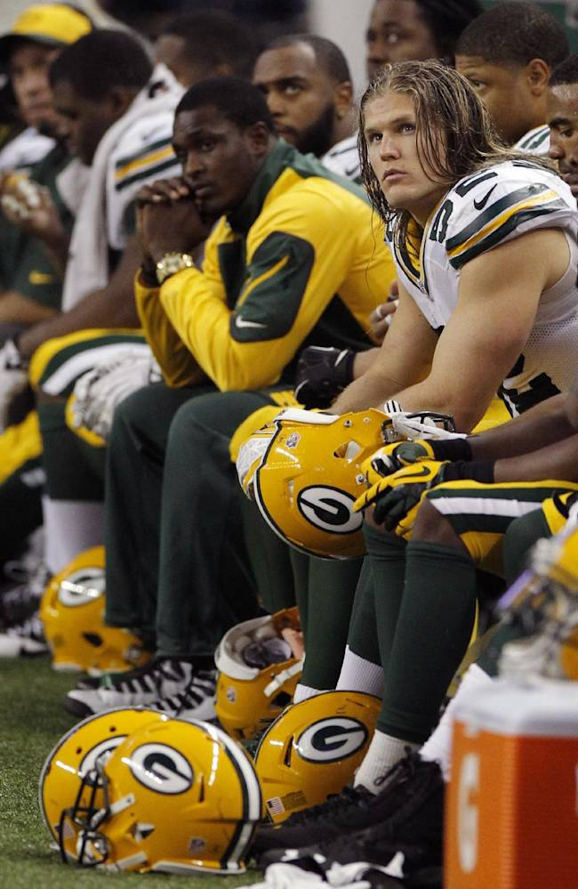 Green Bay Packers outside linebacker Clay Matthews (52) and teammates sit on the bench during the closing minutes of an NFL football game against the Detroit Lions at Ford Field in Detroit, Thursday, Nov. 28, 2013