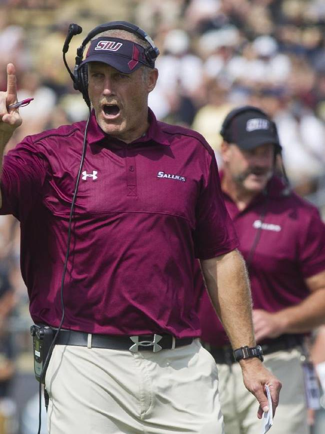 Southern Illinois coach Dale Lennon calls out instructions to his team during an NCAA college football game against Purdue, Saturday, Sept. 20, 2014, in West Lafayette, Ind. Purdue won 35-13