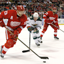 Detroit Red Wings center Pavel Datsyuk (13) skates from Minnesota Wild center Ryan Carter (18) in the first period of an NHL hockey game in Detroit Tuesday, Jan. 20, 2015 The Associated Press