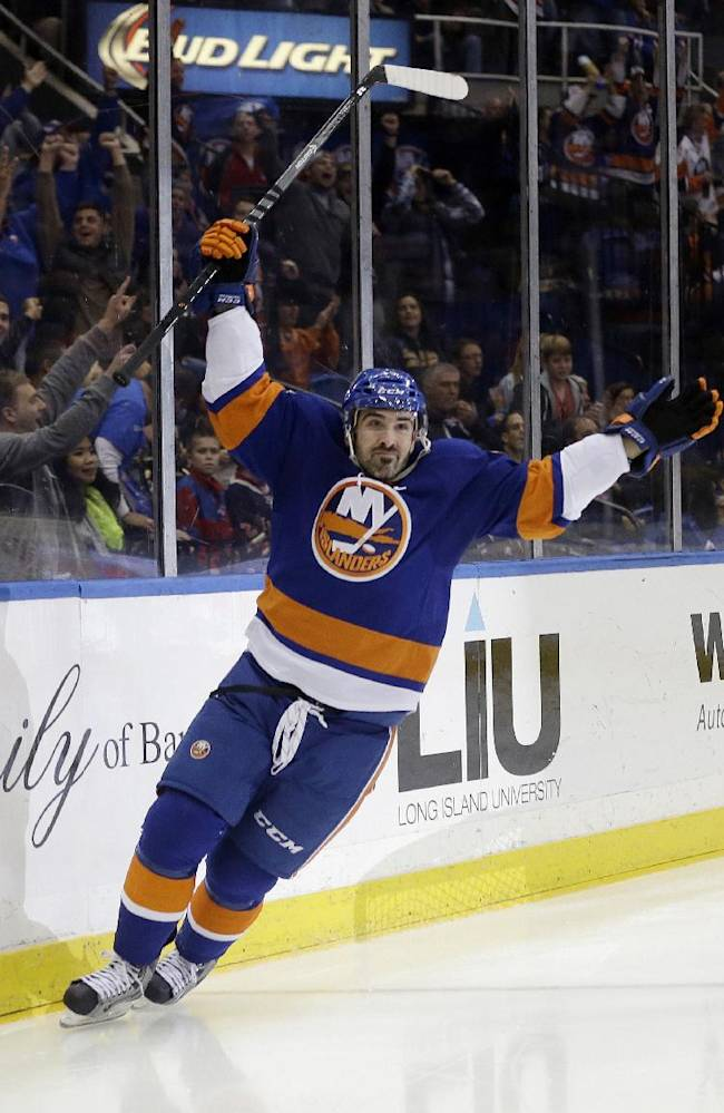 New York Islanders' Cal Clutterbuck (15) celebrates after scoring a goal during the second period of an NHL hockey against the New York Rangers game Tuesday, Oct. 29, 2013, in Uniondale, N.Y