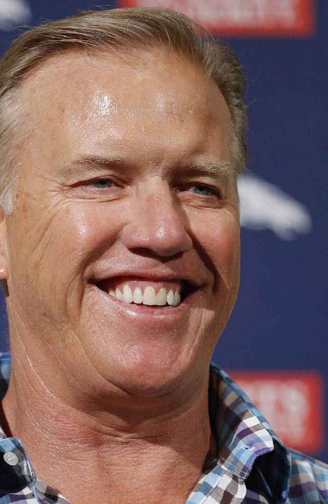 Denver Broncos vice president John Elway smiles as he talks about this weeks NFL football draft during a news conference at the team's headquarters in Englewood, Colo., on Monday, May 5, 2014