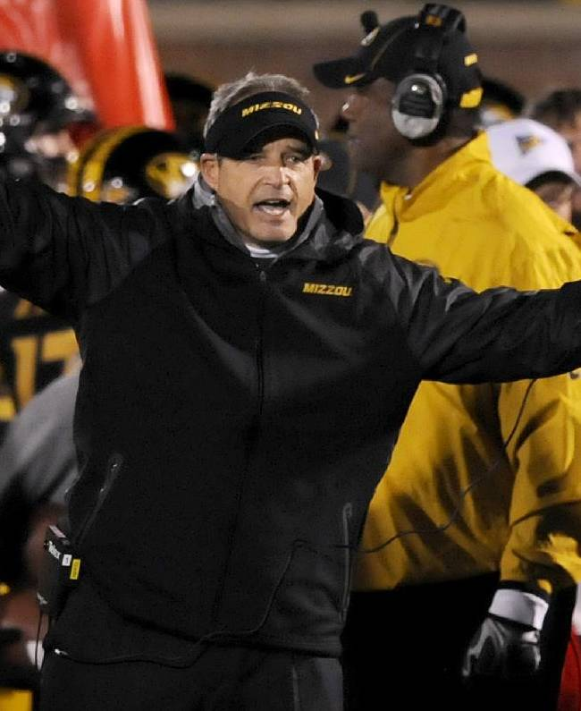 Missouri head coach Gary Pinkel yells on the sidelines during the second half of an NCAA college football game against Tennessee, Saturday, Nov. 2, 2013, in Columbia, Mo