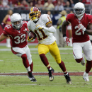 Washington Redskins wide receiver DeSean Jackson (11) runs for a touchdown as Arizona Cardinals free safety Tyrann Mathieu (32) and Patrick Peterson (21) pursue during the first half of an NFL football game, Sunday, Oct. 12, 2014, in Glendale, Ariz The As