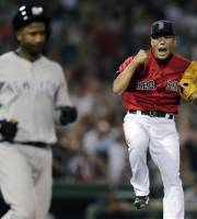 Boston Red Sox relief pitcher Koji Uehara, right, of Japan, leaps and pumps his fist after getting New York Yankees' Eduardo Nunez to ground out to end the game during the ninth inning of a baseball game at Fenway Park, Friday, July 19, 2013, in Boston. (AP Photo/Charles Krupa)