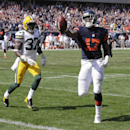 Chicago Bears wide receiver Alshon Jeffery (17) runs to the end zone for a touchdown against Green Bay Packers cornerback Sam Shields (37) in the first half of an NFL football game Sunday, Sept. 28, 2014, in Chicago. The Associated Press