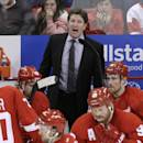 Detroit Red Wings head coach Mike Babcock directs his team during the third period of Game 3 of a first-round NHL hockey playoff series against the Boston Bruins in Detroit, Tuesday, April 22, 2014. (AP Photo/Carlos Osorio)