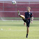U.S. head coach Juergen Klinsmann kicks the ball during a practice session in San Pedro Sula February 5, 2013 file photo. REUTERS/Stringer