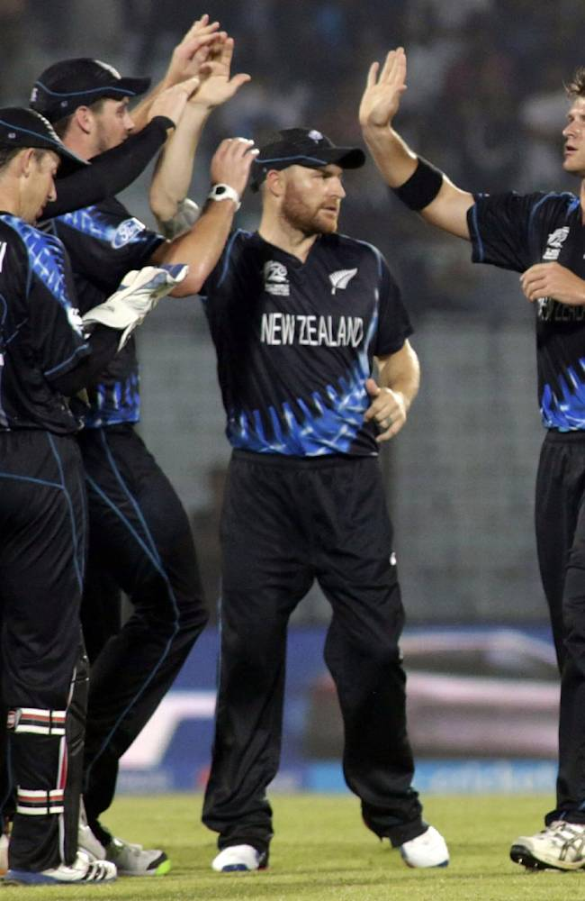 New Zealand's cricket captain Brendon McCullum, center, celebrates with teammates the dismissal of an England wicket during an ICC Twenty20 Cricket World Cup match in Chittagong, Bangladesh, Saturday, March 22, 2014