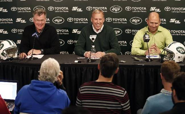 New York Jets general manager John Idzik, center, reacts with senior personnel executive Terry Bradway, left, and  director of college scouting Jeff Bauer, right, while talking to the press during a news conference ahead of the NFL football draft, Wednesday, April 30, 2014, in Florham Park, N.J. The NFL will hold its draft from May 8-10, at New York's Radio City Music Hall. (AP Photo)