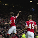 Manchester United's Juan Mata, left, celebrates after scoring during the English Premier League soccer match between Manchester United and Liverpool at Old Trafford Stadium, Manchester, England, Sunday Dec. 14, 2014