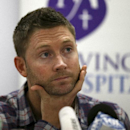 Australia cricket captain Michael Clarke touches his face just before reading a statement following the death of fellow cricketer Phillip Hughes during a press conference at St. Vincent's Hospital in Sydney, Thursday, Nov. 27, 2014. Hughes, 25, died in th