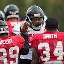 Atlanta Falcons defensive end Cliff Matthews, centre, high fives his teammates during a training session at the Arsenal FC training ground in London Colney, England, Wednesday Oct. 22, 2014. The Falcons will play the Detroit Lions in an NFL football game