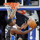 Orlando Magic guard Victor Oladipo, left, goes up for a shot as New York Knicks' Kenyon Martin defends during the second quarter of an NBA basketball game Friday, Dec. 6, 2013, at Madison Square Garden in New York The Associated Press