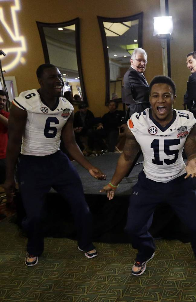 Auburn's Joshua Holsey (15) and Jeremy Johnson dance during media day for the NCAA BCS National Championship college football game Saturday, Jan. 4, 2014, in Newport Beach, Calif. Florida State plays Auburn on Monday, Jan. 6, 2014