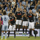 Philadelphia Union midfielder Michael Lahoud (13), defender Fabinho (33), midfielder Michael Farfan (21) and forward Conor Casey (6) try to block a free kick during the first half of an MLS soccer match against Sporting KC in Kansas City, Kan., Friday, Sept. 27, 2013. (AP Photo/Orlin Wagner)