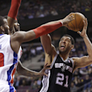 San Antonio Spurs forward Tim Duncan (21) shoots over the defense of Detroit Pistons forward Greg Monroe, left, and Josh Smith during the first half of an NBA basketball game in Auburn Hills, Mich., Monday, Feb. 10, 2014 The Associated Press