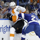 Philadelphia Flyers center Vincent Lecavalier (40) loses the puck as he gets pinned against the boards by Tampa Bay Lightning defenseman Mike Kostka (21) during the first period of an NHL hockey game Thursday, April 10, 2014, in Tampa, Fla The Associated