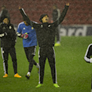Real Madrid's Cristiano Ronaldo, center, reacts as he stands in heavy rain shower during training with teammates at Anfield Stadium, in Liverpool, England, Tuesday, Oct. 21, 2014. Real Madrid will play Liverpool in a Champion's League Group B soccer match