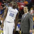 FILE - In this March 15, 2014, file photo, Kentucky head coach John Calipari and forward Alex Poythress (22) watch play against Georgia during the second half of an NCAA college basketball game in the semifinal round of the Southeastern Conference men's tournament in Atlanta. Poythress will miss the rest of the season after tearing a knee ligament during practice the school said Thursday, Dec. 11, 2014. (AP Photo/Steve Helber, File)