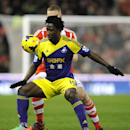 Swansea's Wilfried Bony, front, competes for the ball with Stoke's Ryan Shawcross during the English Premier League soccer match between Stoke City and Swansea City at Britannia Stadium in Stoke on Trent, England, Wednesday, Feb. 12, 2014