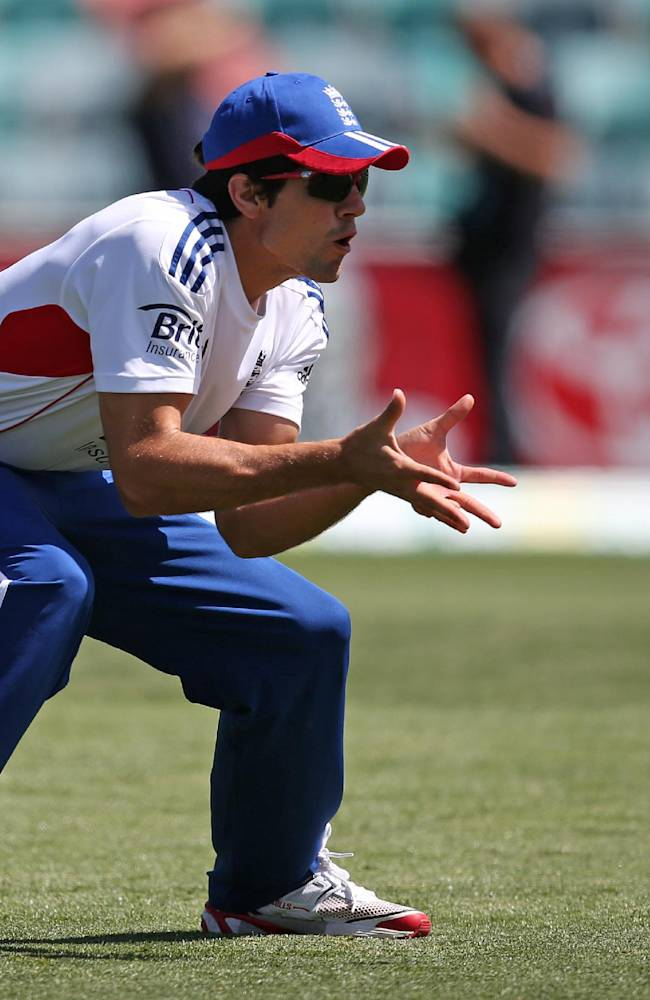 England's cricket captain Alastair Cook fields a ball during training in Hobart in Tasmania, Australia, Tuesday, Nov. 5, 2013. England will play Australia A in a 4-day tour match from Wednesday