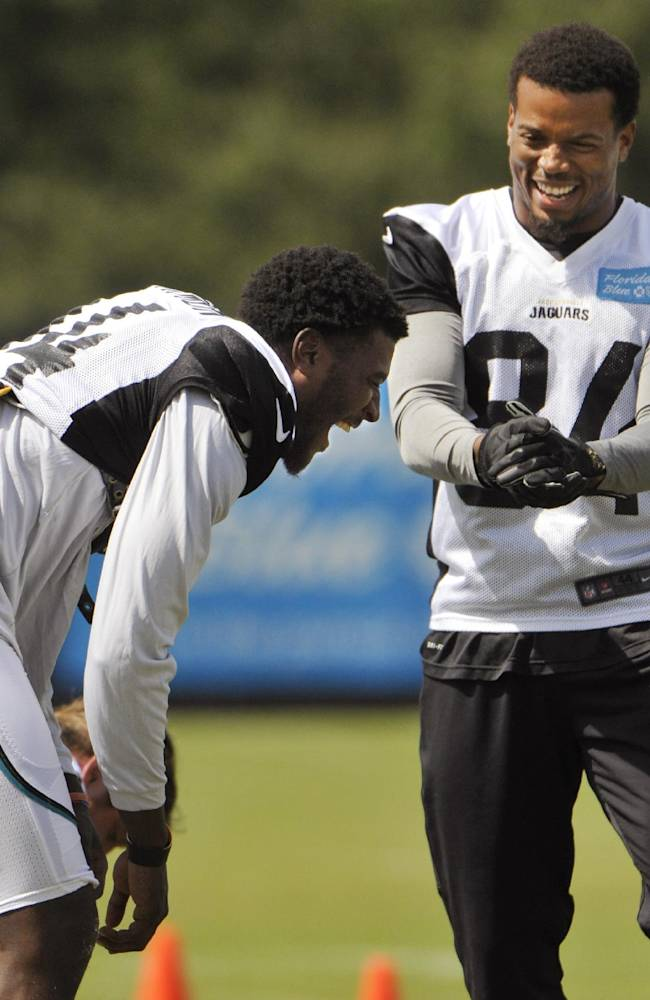 Jacksonville Jaguars wide receiver Justin Blackmon, left, and Cecil Shorts share a laugh during during NFL football practice, Wednesday, Oct. 2, 2013, in Jacksonville, Fla. Blackmon returned to the team Wednesday, after a four-game suspension for violating the league's substance-abuse policy