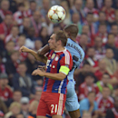 Manchester City's Fernandinho, rear, and Bayern's Philipp Lahm challenge for the ball during the Champions League group E soccer match between Bayern Munich and Manchester City in Munich, Germany, Wednesday Sept.17,2014
