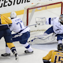 Nashville Predators forward Matt Cullen (7) scores a goal past Tampa Bay Lightning defenseman Victor Hedman (77), of Sweden, and goalie Ben Bishop (30) in the second period of an NHL hockey game, Thursday, Feb. 27, 2014, in Nashville, Tenn The Associated