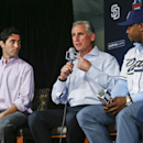 San Diego Padres manager Bud Black points toward general Manager A. J. Preller while flanked by outfielder Justin Upton as he talks about the teams' recent acquisitions at news conference where the Padres introduced four new players Tuesday, Jan. 6, 2015