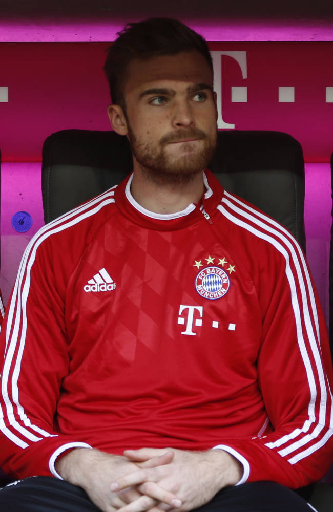 In this Oct. 26, 2013 file picture Bayern's Jan Kirchhoff sits on the bench prior to the German first division Bundesliga soccer match between FC Bayern Munich and Hertha BSC Berlin, in Munich, southern Germany. Bayern Munich is sending defender Jan Kirchhoff on loan to Bundesliga rival Schalke until the end of next season.  Bayern chairman Karl-Heinz Rummenigge says the 22-year-old Kirchhoff's move is a good decision for all concerned. Kirchhoff will reinforce Schalke's defense and Rummenigge says he will get playing time that