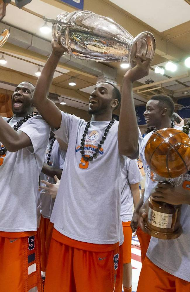 Syracuse players hold trophies after Syracuse won the Maui Invitational with a 74-67 win over Baylor in an NCAA college basketball game Wednesday, Nov. 27, 2013, in Lahaina, Hawaii