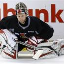 Ottawa Senators goaltender Craig Anderson stretches during the team's practice ahead of Game 5 in their NHL hockey Stanley Cup playoffs Eastern Conference semifinal against the Pittsburgh Penguins in Ottawa, Ontario, on Tuesday, May 21, 2013. (AP Photo/The Canadian Press, Patrick Doyle)