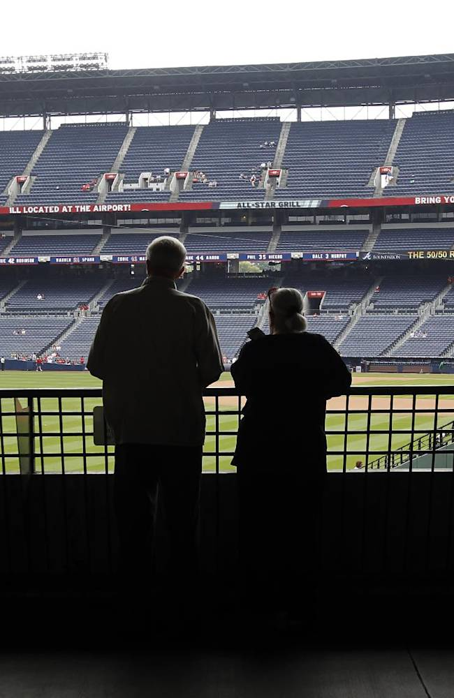 Fans watch batting practice before a baseball game between the Atlanta Braves and the San Diego Padres at Turner Field on Sunday, Sept. 15, 2013, in Atlanta