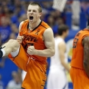 Oklahoma State's Phil Forte celebrates defeating Kansas in an NCAA college basketball game in Lawrence, Kan. on Saturday, Feb. 2, 2013. (AP Photo/The Wichita Eagle, Travis Heying)