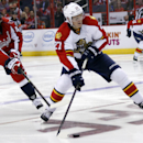Washington Capitals right wing Joel Ward (42) defends against Florida Panthers center Nick Bjugstad (27) in the second period of an NHL hockey game, Saturday, Oct. 18, 2014, in Washington The Associated Press