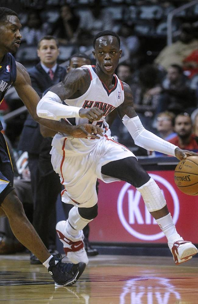 Atlanta Hawks' Dennis Schroder (17), of Germany, drives against the defense of Memphis Grizzlies' Tony Allen (9) during an NBA preseason basketball game, Sunday, Oct. 20, 2013, in Atlanta