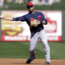 Cleveland Indians' Elliot Johnson throws to first after fielding a ground out by Texas Rangers' Brent Lillibridge in the third inning of a spring training exhibition baseball game, Monday, March 3, 2014, in Surprise, Ariz The Associated Press