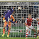 Anderlecht's Andy Najar heads the ball to score his team's first goal passing Arsenal's goalkeeper Emiliano Martinez, rear in orange, during the Group D Champions League match between Anderlecht and Arsenal at Constant Vanden Stock Stadium in Brussels, B